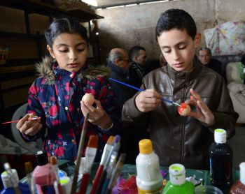 Children paint eggs after Easter Monday Mass at St. Mary's Church in Iqrit, Israel, April 13. CNS photo/Debbie Hill)