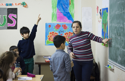 Iraqi refugee Basima Toma teaches English class March 24 at Don Bosco youth center in Istanbul. Like Toma, most of the teachers at the school are refugees or asylum seekers. (CNS photo/Elie Gardner)
