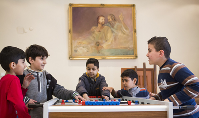 Boys play foosball March 25 at Don Bosco youth center in Istanbul. (CNS photo/Elie Gardner)