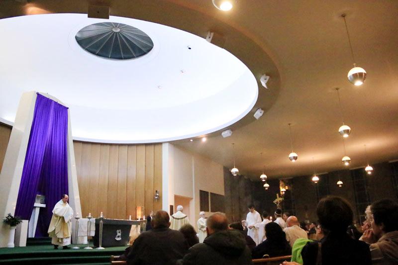 Fr Thomas Nasta transfers the eucharist from the church