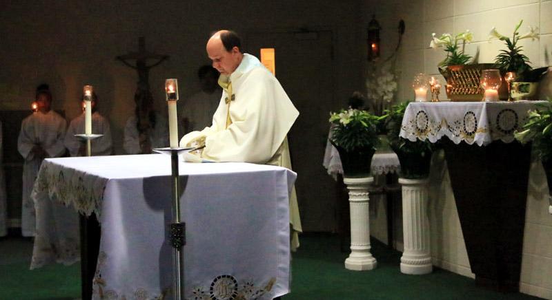 Fr Thomas Nasta transfers the eucharist to the chapel