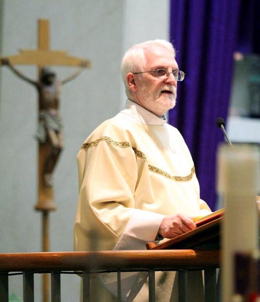 Deacon Ralph Shirley reads the Gospel