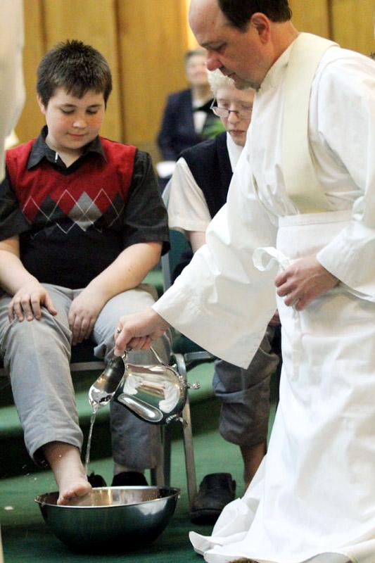 Fr Thomas Nasta washes the feet of Jared Moylan