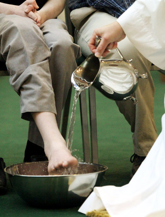 Fr Thomas Nasta washes the feet of the people of the parish