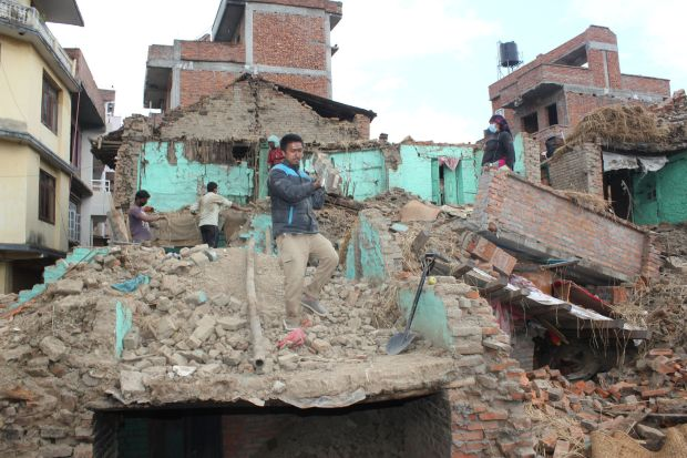 Earthquake survivors of Safal Tol village on the outskirts of Kathmandu, Nepal, retrieve belongings from their destroyed homes April 29, five days after a major earthquake struck the region. (CNS photo/Anto Akkara)