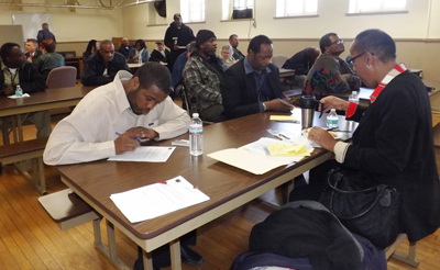Veterans sign up for essential services during an open screening day.