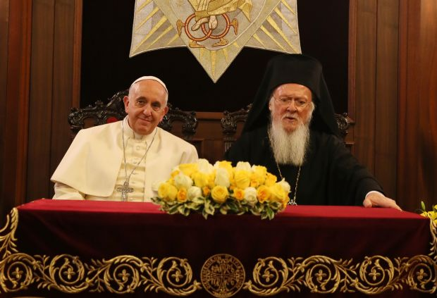 Pope Francis and Ecumenical Patriarch Bartholomew of Constantinople sit during signing of joint declaration at the patriarchal Church of St. George in Istanbul in this Nov. 30, 2014 file photo. (CNS photo/Grzegorz Galazka, pool)