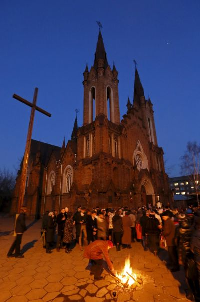 People light candles in front of a Catholic church during the Easter Vigil in the Siberian city of Krasnoyarsk, Russia, April 4. A Russian church official said the bishops' conference is studying the implications of a new government law tightening control over the funding of churches and religious associations. (CNS photo/Ilya Naymushin, Reuters) See RUSSIA-LAW April 22, 2015.