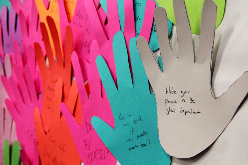 Students wrote on hands things they learned or can pledge to do to not be a distracted driver.
