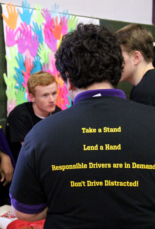 Teeshirts for NOYS that said Take a Stand, Lend a Hand, Responsible Driver are in Demand, Don't Drive Distracted! were given to all SADD members and raffled off to other students.