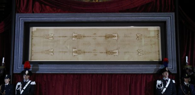 The Shroud of Turin is displayed during a preview for journalists at the Cathedral of St. John the Baptist in Turin, Italy, April 18. (CNS photo/Paul Haring)
