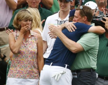 U.S. golfer Jordan Spieth hugs his father, Shawn, as his mother, Chris, looks on April 12 after the 21-year-old won the Masters golf tournament at Augusta National Golf Course in Georgia. Spieth attended St. Monica's Catholic School in Dallas and graduated in 2011 from Jesuit College Prep in Dallas. (CNS photo/Mark Blinch, Reuters)