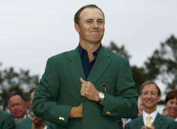 U.S. golfer Jordan Spieth smiles April 12 as he wears his champion green jacket on the putting green at the Augusta National Golf Course in Georgia after winning the Masters golf tournament. (CNS photo/Brian Snyder, Reuters)