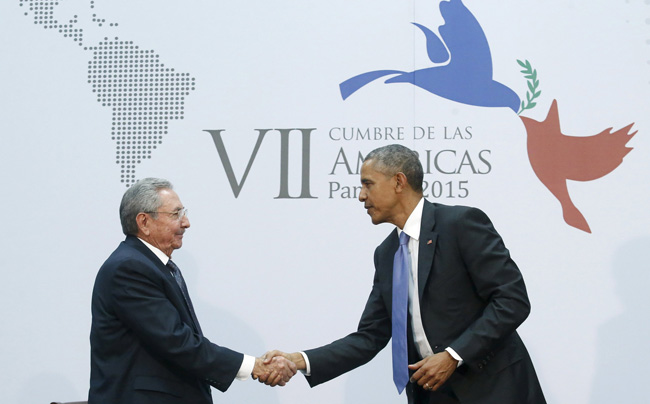 Cuba's President Raul Castro shakes hands with U.S. President Barack Obama as they hold a bilateral meeting during the seventh Summit of the Americas in Panama City  April 11. (CNS photo/Jonathan Ernst, Reuters)