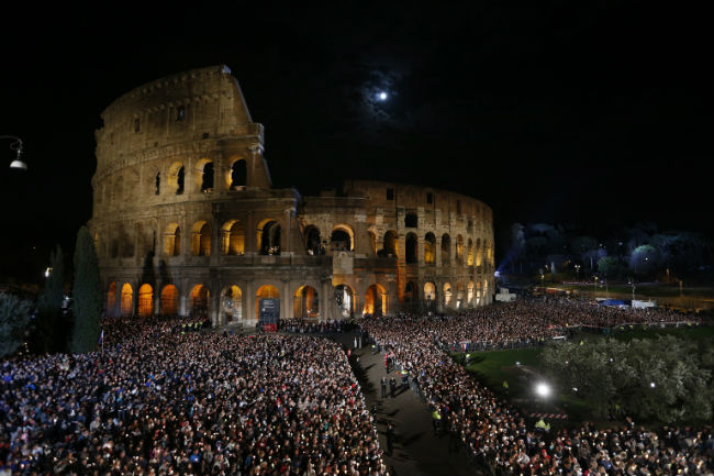 The moon is seen over Rome's Colosseum April 3 as Pope Francis leads the Good Friday Way of the Cross. (CNS photo/Paul Haring)