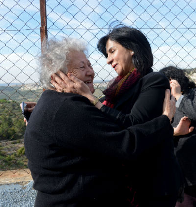 Bethlehem Mayor Vera Baboun, right, congratulates a Palestinian Christian and owner of property in Cremisan, Yusra Araja, 75, from Beit Jala, after a news conference at a convent in Cremisan Valley in Beit Jala, West Bank, April 2. (CNS photo/Debbie Hill)