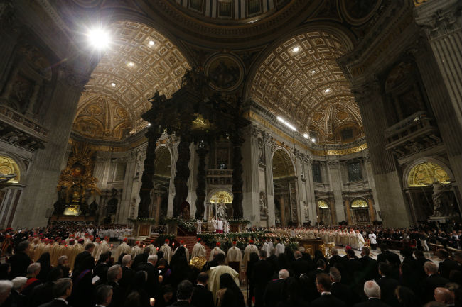 Pope Francis celebrates the Easter Vigil in St. Peter's Basilica at the Vatican April 4. (CNS photo/Paul Haring)