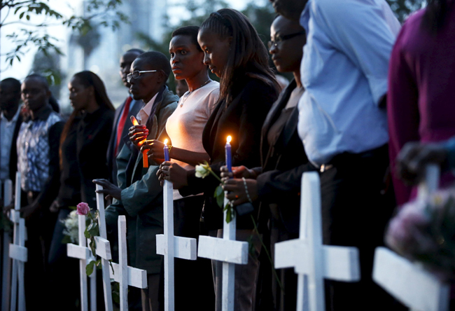 People attend a memorial vigil in Nairobi, Kenya, April 7, for the 147 people killed in an attack on Garissa University College.  (CNS photo/Goran Tomasevic, Reuters)