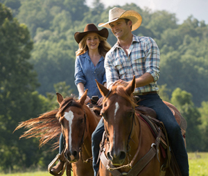"Britt Robertson and Scott Eastwood star in a scene from the movie ""The Longest Ride."" The Catholic News Service classification is A-III -- adults. The Motion Picture Association of America rating is PG-13 -- parents strongly cautioned. Some material may be inappropriate for children under 13. (CNS photo/Fox) See MOVIE REVIEW (EMBARGOED) April 8, 2015."