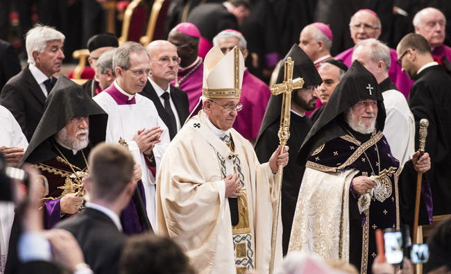 Pope Francis is flanked by Catholicos Aram of Cilicia, Lebanon, left, and Catholicos Karekin II of Etchmiadzin, patriarch of the Armenian Apostolic Church, as he leaves after celebrating an April 12 Mass in St. Peter's Basilica at the Vatican to mark the 100th anniversary of the Armenian genocide. (CNS photo/Cristian Gennari)