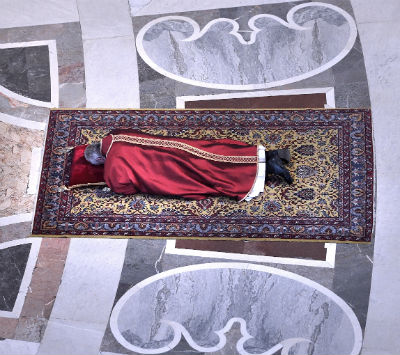 Pope Francis lies prostrate at the beginning of the Good Friday liturgy in St. Peter's Basilica at the Vatican April 3. (CNS photo/Stefano Spaziani, pool)