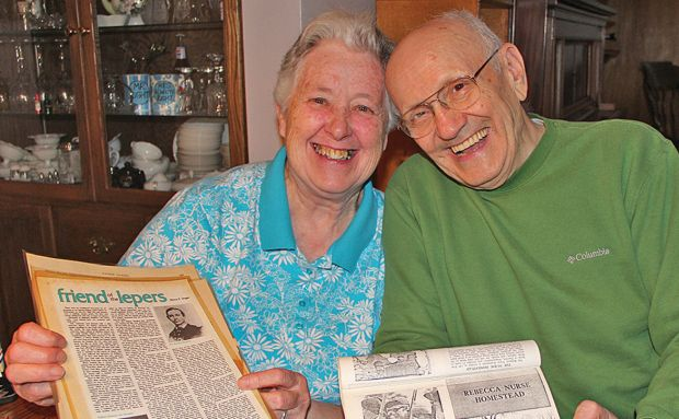 Pat and Jerry Nurss of Oil City, Pa., display some of the reams of documents and photographs about their family lineage April 8, which includes a saint and a seventh great-grandmother hanged for witchcraft. (CNS photo/Mary Solberg, Diocese of Erie)