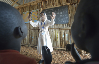 Sister Mariya Soosai, a member of the Daughters of Mary Immaculate, leads a group of children March 7 in an arithmetic class in a camp for internally displaced families inside a U.N. base in Juba, South Sudan. Some 34,000 people have sought protection at the base since violence broke out in December 2013. (CNS photo/Paul Jeffrey)
