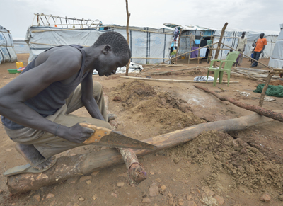 A man constructs a shelter inside a U.N. base in Juba, South Sudan, March 7. (CNS photo/Paul Jeffrey)