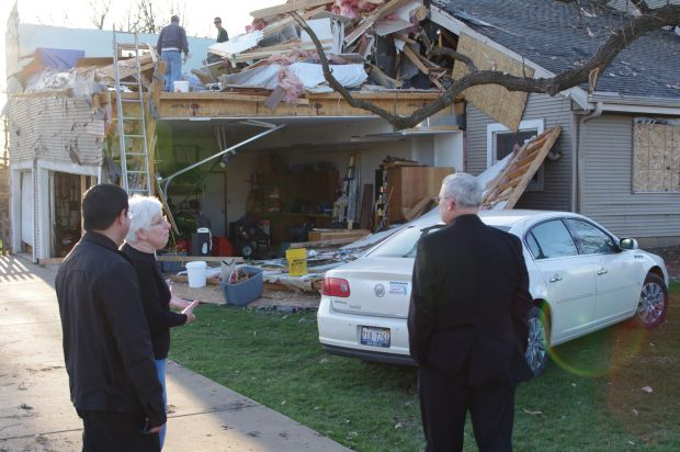 Cecilie Schwartz talks to Father Johnson Lopez, pastor of St. Patrick Parish in Rochelle, Ill., and Bishop David J. Malloy of Rockford, Ill., April 11, the EF4 tornado that damaged her home and 29 others in her neighborhood the night of April 9. (CNS photo/Penny Wiegert, Catholic Observer)