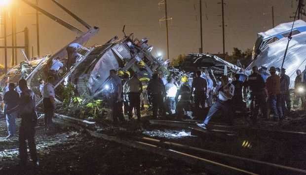 Rescue workers search for victims in the wreckage of a derailed Amtrak train in Philadelphia May 12. At least seven people died and eight others were in critical condition as a result of the crash, a doctor from Temple University Hospital said the morning of May 13. (CNS photo/Bryan Woolston, Reuters)