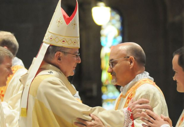 Archbishop John C. Nienstedt of St. Paul and Minneapolis offers the greeting of peace to Deacon Vaughn Treco May 2 at the Basilica of St. Mary in Minneapolis. A day later Deacon Treco, a former Anglican priest, became Father Treco when ordained a Catholic priest by Auxiliary Bishop Andrew H. Cozzens at Holy Family Church in suburban St. Louis Park. (CNS photo/Dianne Towalski, The Catholic Spirit)