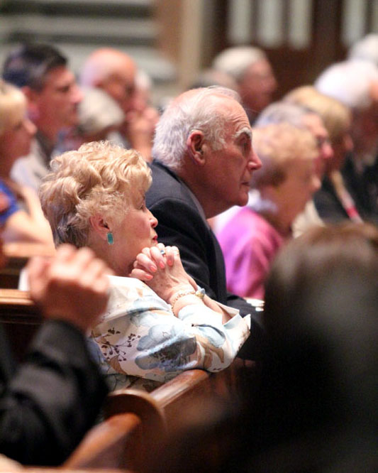 Couples pray during the wedding anniversary Mass May 2 at the Cathedral of SS. Peter and Paul. (Sarah Webb)