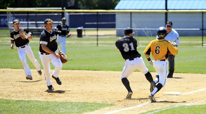teamwork between firstbaseman 25 Louis Testa and pticher 31 Pat Doudican get the out at first on Wood 6 Anthony Zupito