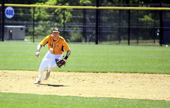 Wood 3 Matt Cumminskey stays on the ball to make the play