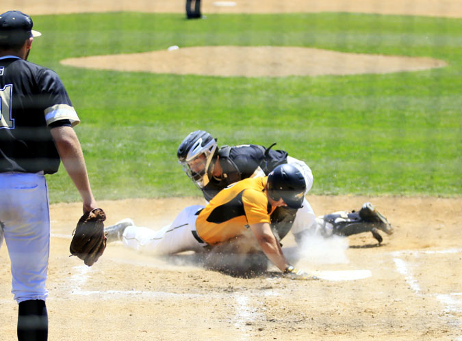 Cathcher Tommy Nardini tags out Wood 15 Austin Hill from being the third run on a triple hit by 5 Matt Schwartz