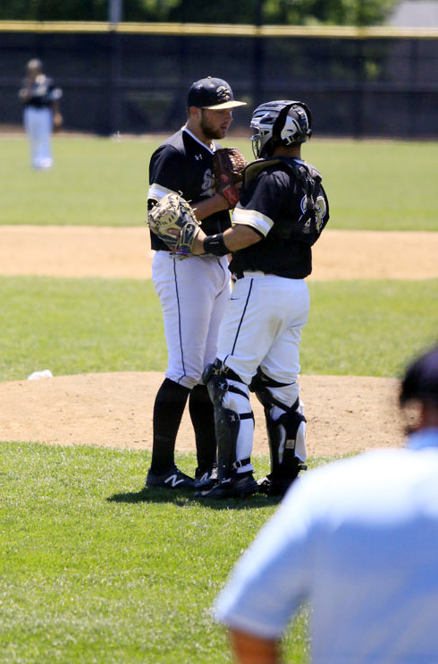 NG pitcher 31 Pat Doudican and cathcer 23 Tommy Nardini confer