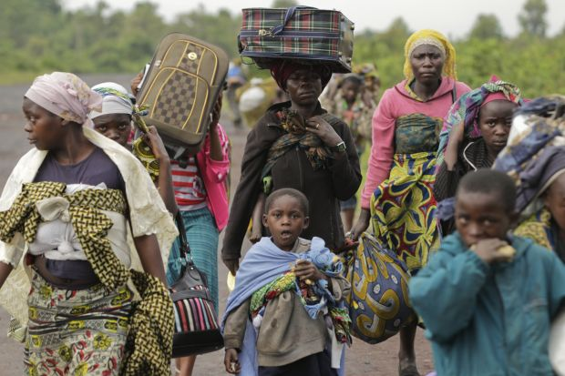 "Villagers walk toward Goma, Congo, to flee regional fighting in 2012. Bishops from eastern Congo criticized the failure of their government and the United Nations to act against ""genocide, jihadist fundamentalism and Balkanization"" in the country. (CNS photo/Dai Kurokawa, EPA)"