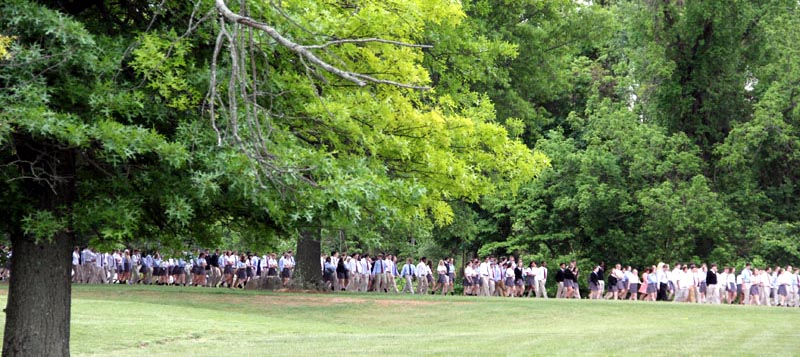 The entire student body process from the school to the entrance of the campus for the statue blessing.