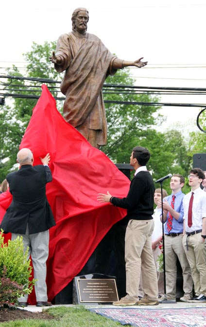 The statue is unveiled May 21 at Archbishop Carroll High School. (Sarah Webb)