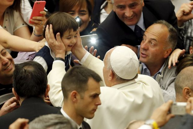 Pope Francis greets a child as he arrives to attend an audience with members of Christian Life Community in Paul VI hall at the Vatican April 30. (CNS photo/Giampiero Sposito, Reuters)