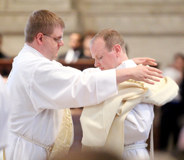Soon to be ordained a priest, Deacon Steven Kiernan vest Matthew Windle
