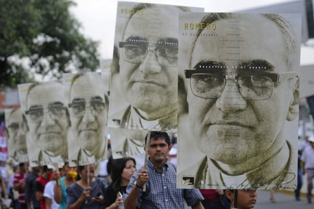 People carry large portraits of Salvadoran Archbishop Oscar Romero during a rally in late March in San Salvador to pay tribute to the late archbishop, who was assassinated 35 years ago.  (CNS photo/Roberto Escobar, EPA)