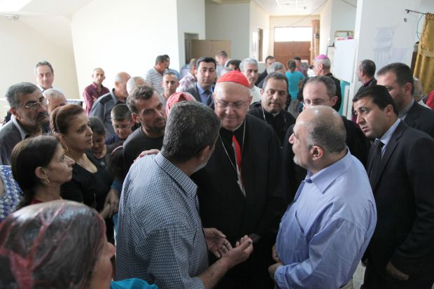 Cardinal Leonardo Sandri, prefect of the Congregation for Eastern Churches, speaks with displaced Iraqis May 4 in Irbil, Iraq. (CNS photo/John E. Kozar, CNEWA)