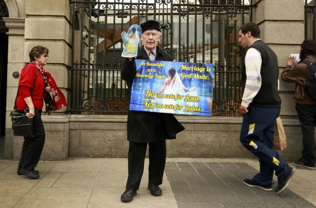 A man opposed to same-sex marriage stands outside the Irish parliament in Dublin May 20.(CNS photo/Cathal McNaughton, Reuters)
