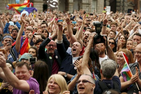 """People in Dublin react as Ireland voted in favor of allowing same-sex marriage May 23. Archbishop Diarmuid Martin said the church needs a """"reality check"""" after Irish voters overwhelmingly supported same-sex marriage. (CNS photo/Cathal McNaughton, Reuters) See IRELAND-MARRIAGE May 26, 2015."""