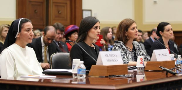 "Sister Diana Momeka, a member of the Dominican Sisters of St. Catherine of Siena in Mosul, Iraq, testifies alongside others at a May 13 hearing on Capitol Hill in Washington titled ""Ancient Communities Under Attack: ISIS's War on Religious Minorities."" Also pictured are Jacqueline Isaac, vice president of Roads of Success in Los Angeles; Hind Kabawat, director of Interfaith Peacebuilding Center for World Religious, Diplomacy and Conflict Resolution at George Mason University in Virginia; and Katharyn Hanson, a fellow in the Penn Cultural Heritage Center at the University of Pennsylvania Museum. (CNS photo/Bob Roller)"