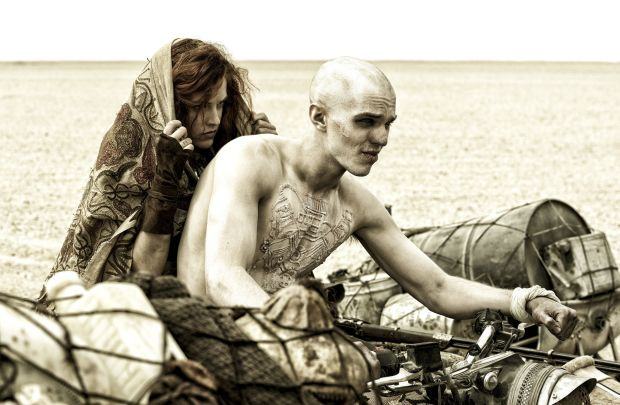 "Riley Keough and Nicholas Hoult star in a scene from the movie ""Mad Max: Fury Road."" (CNS photo/Jasin Boland, Warner Bros.)"