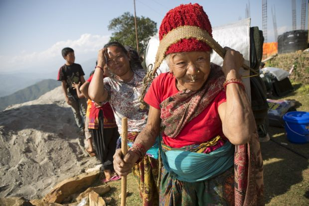 Earthquake survivors are seen near a village in Gorkha, Nepal, May 3. (CNS photo/Jake Lyell, CRS)