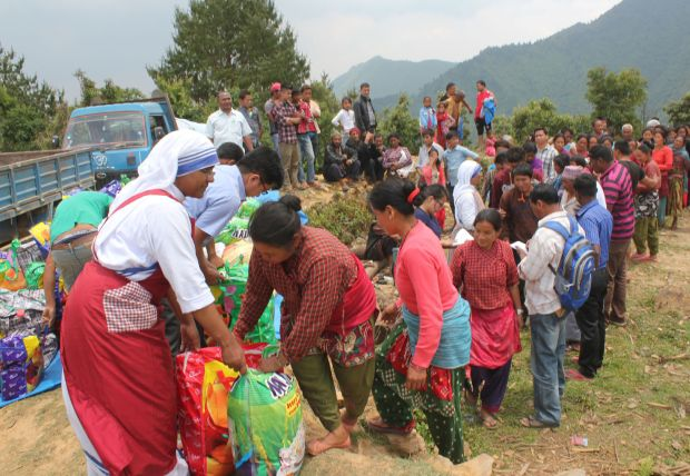 A member of the Missionaries of Charity helps distribute relief items to earthquake victims May 16  in the mountains overlooking Kathmandu Valley in Nepal. (CNS photo/Anto Akkara)
