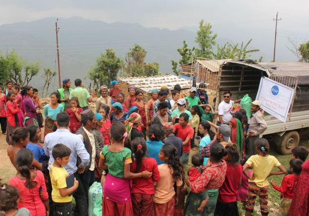 Relief workers from the St. Vincent de Paul Society of Assumption Parish in Lalitpur, Nepal, distribute food items and tents May 9 for Hindus and Muslims on top of Baretol mountain. The village was affected by the magnitude-7.3 earthquake April 25. (CNS photo/Anto Akkara)